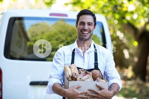 Portrait of cheerful delivery person