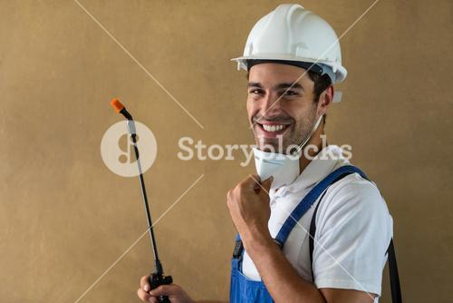 Portrait of happy manual worker with pesticide