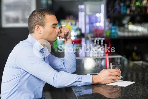 Worried businessman drinking whisky