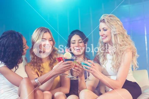 Pretty girls with cocktails