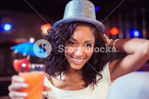 Pretty girl with cocktail and glitter hat