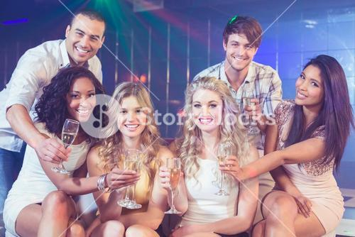 Friends holding champagne glasses