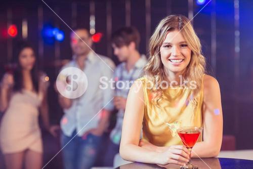 Pretty woman with a cocktail
