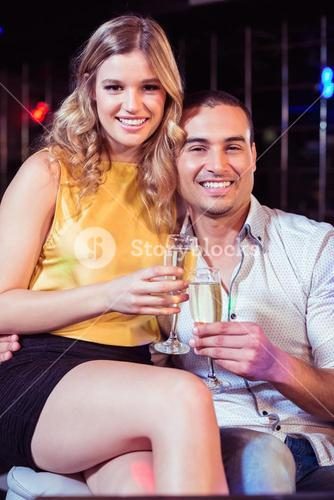 Smiling couple with champagne