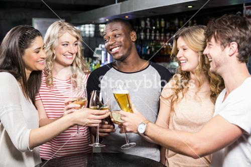 Group of friends toasting with beer and wine
