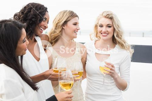 Well dressed men drinking wine next to a limousine