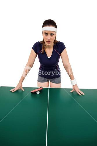 Angry female athlete leaning on hard table