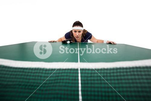 Confident female athlete leaning on hard table