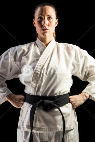 Female fighter standing with hand on hip