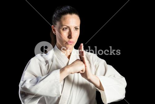 Female fighter performing hand salute