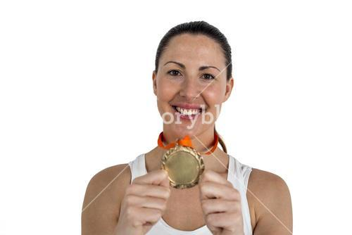 Female athlete posing with gold medals after victory