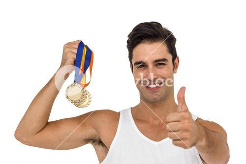 Athlete posing with gold medals