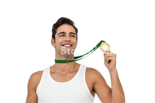 Athlete posing with gold medals around his neck
