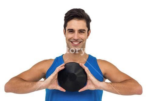 Male athlete posing with discus throw
