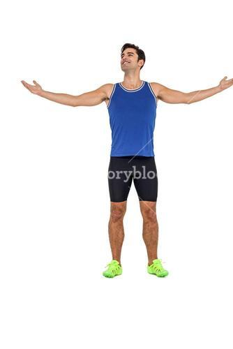 Athlete standing with arms outstretched