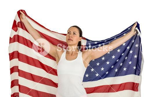 Female athlete posing with american flag