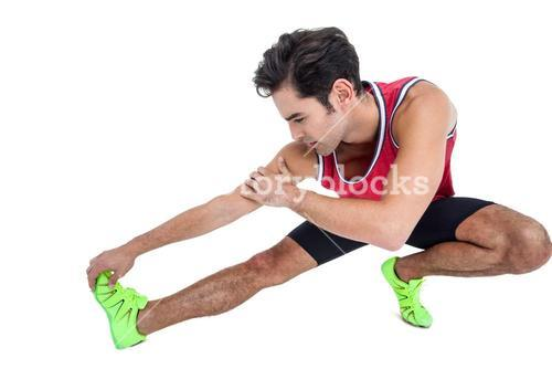 Male athlete stretching his hamstring