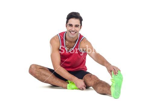 Portrait of male athlete stretching his hamstring