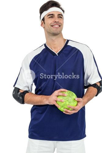 Sportsman standing with ball on white background