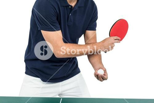 Mid section of athlete man playing table tennis