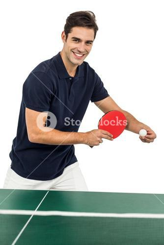 Portrait of male athlete playing table tennis