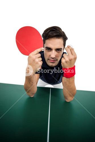 Confident male athlete leaning on hard table