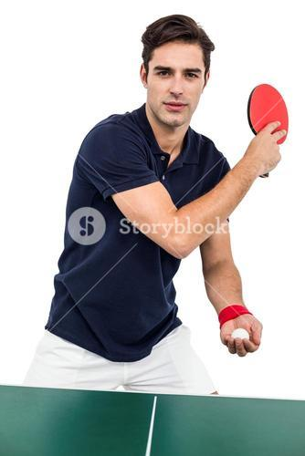 Confident male athlete playing table tennism