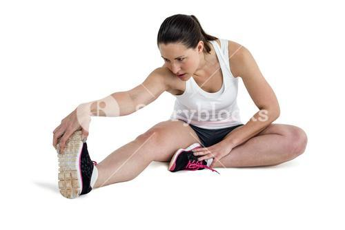 Athlete woman stretching her hamstring