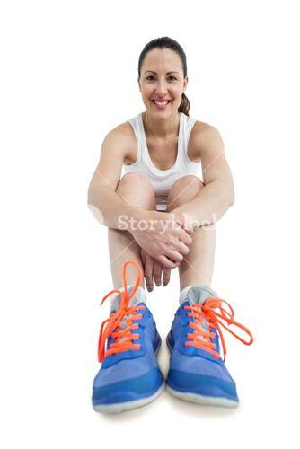 Portrait of athlete woman sitting with sports shoes