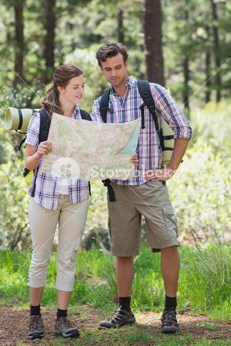 Couple holding map and planning