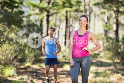 Young healthy couple at forest