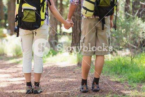 Low section of couple holding hands