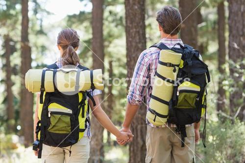 Rear view of couple holding hands and standing