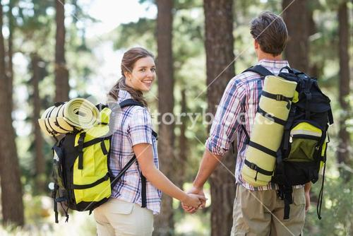 Couple holding hands while hiking