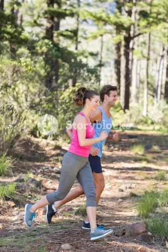 Young healthy couple running