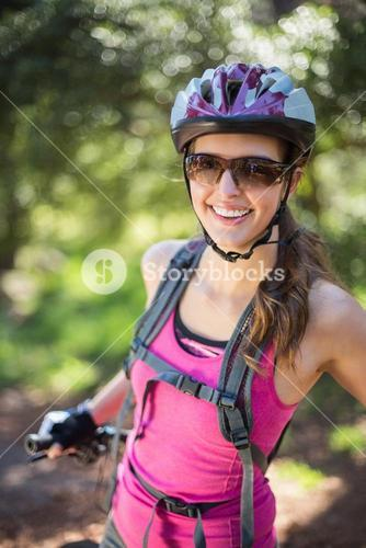 Portrait of smiling woman at forest