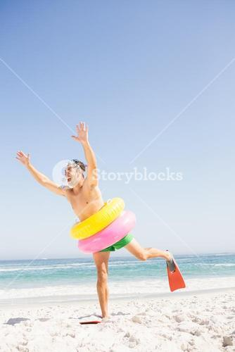 Smiling man posing with rubber ring