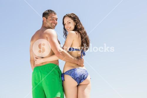 Couple with arm around each other