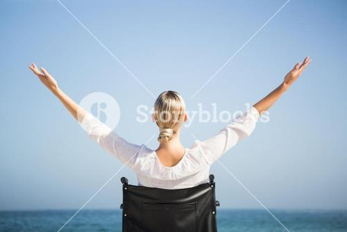 Woman in a wheelchair relaxing