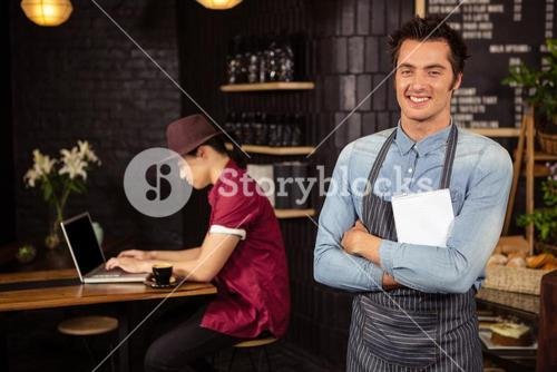 Waiter with arms crossed