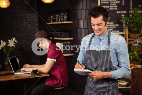 Waiter writing down the orders
