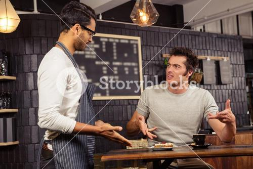 Waiter and customer having a discussion