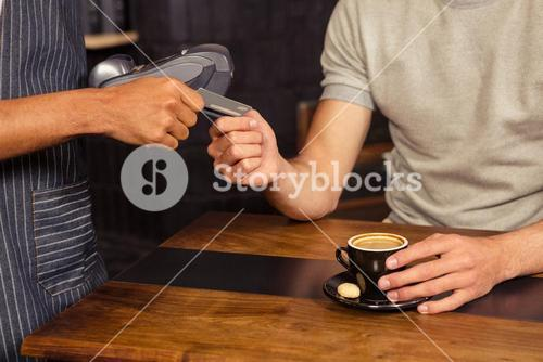 Man paying his bill with credit card