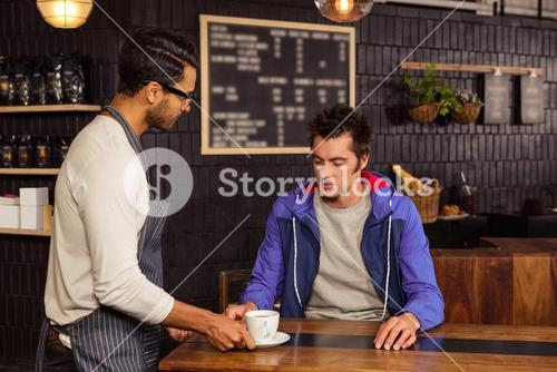 Waiter serving a coffee