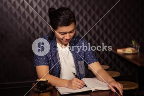 Man taking notes