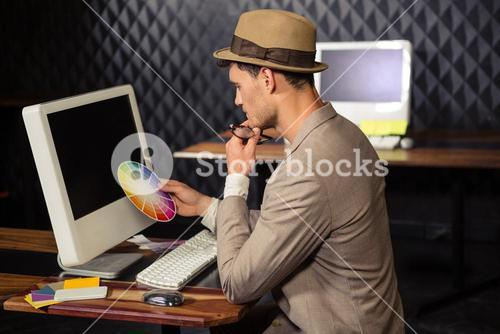 Creative businessman using colour sample