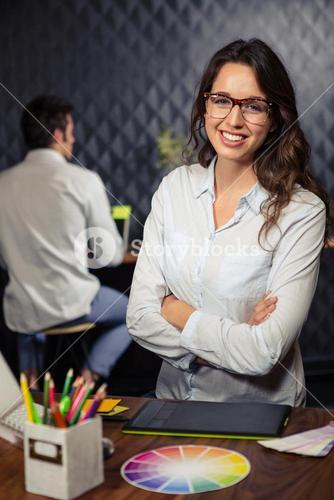 Creative businesswoman with arms folded