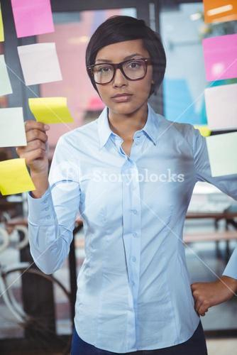 Portrait of businesswoman with sticky note