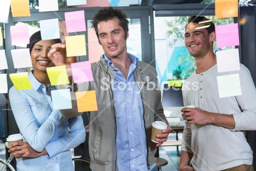 Colleagues looking at sticky notes