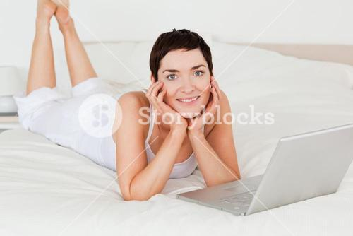 Woman posing with a laptop